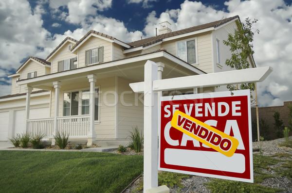 Vendido Se Vende Casa Spanish Real Estate Sign and House Stock photo © feverpitch