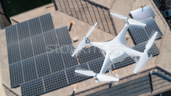 UAV Drone Inspecting Solar Panels On Large House Stock photo © feverpitch
