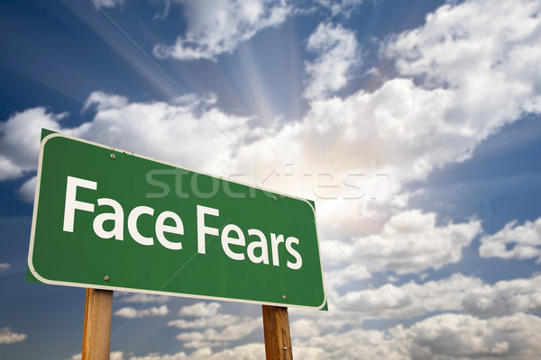 Face Fears Green Road Sign and Clouds Stock photo © feverpitch