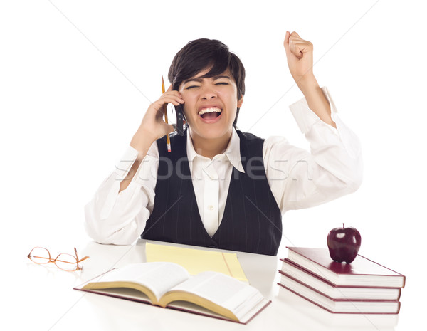Excited Mixed Race Female Student on Cell Phone Cheers Stock photo © feverpitch