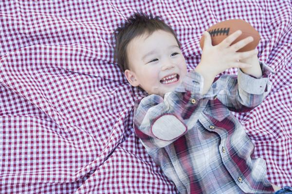 Jovem menino jogar futebol toalha de piquenique Foto stock © feverpitch