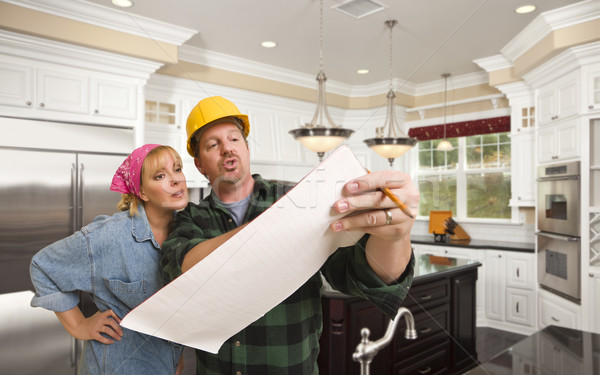 Contractor Discussing Plans with Woman Inside Custom Kitchen Int Stock photo © feverpitch