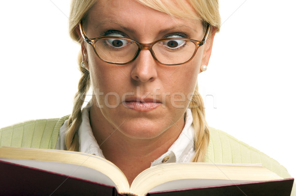 Stunned Female with Ponytails and Book Stock photo © feverpitch
