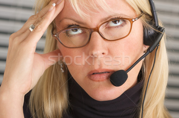 Businesswoman with Phone Headset and Headache Stock photo © feverpitch