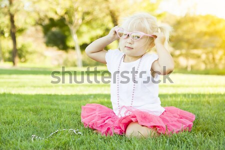 Stock photo: Little Girl Playing Dress Up With Pink Glasses and Necklace