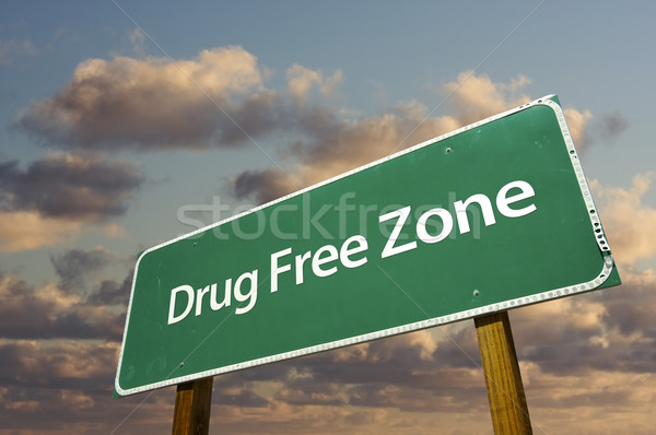 Drug Free Zone Green Road Sign Over Clouds Stock photo © feverpitch