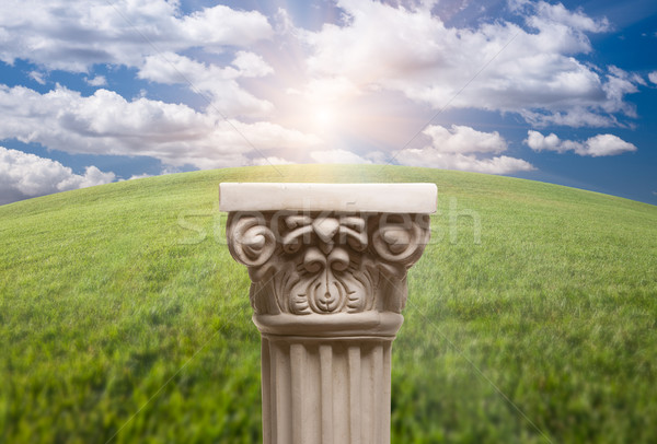 Ancient Replica Column Pillar Over Grass and Clouds Stock photo © feverpitch