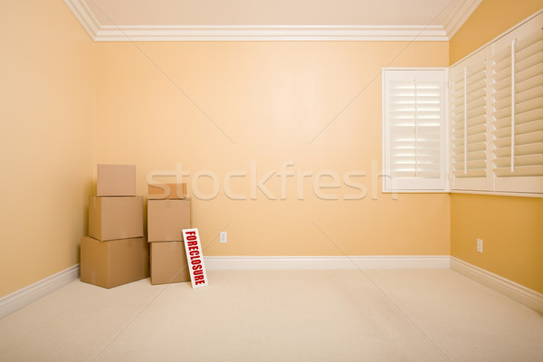 Moving Boxes and Foreclosure Real Estate Sign on Floor in Empty  Stock photo © feverpitch
