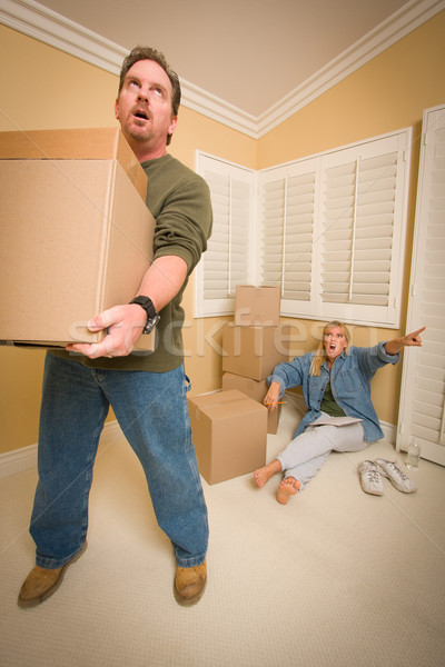 Stressed Man Moving Boxes for Demanding Wife Stock photo © feverpitch