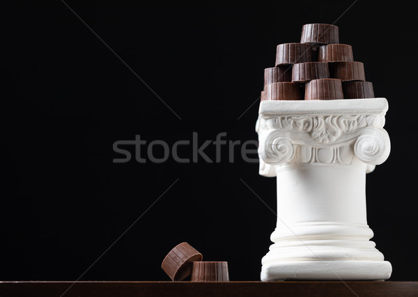 Stock photo: Stack of Fine Artisan Chocolates Stacked On White Pillar Column