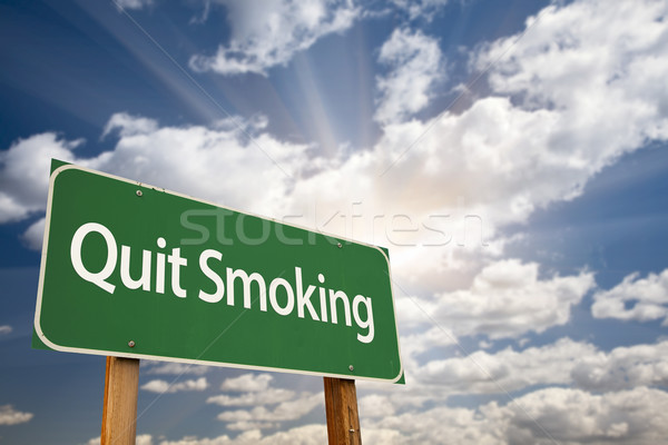 Quit Smoking Green Road Sign and Clouds Stock photo © feverpitch