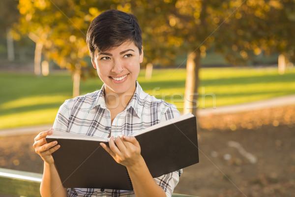 Félvér fiatal női tart nyitott könyv ceruza Stock fotó © feverpitch