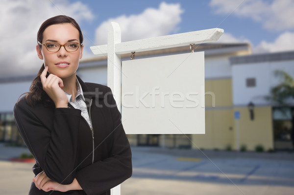 Woman In Front Commercial Building and Blank Real Estate Sign Stock photo © feverpitch