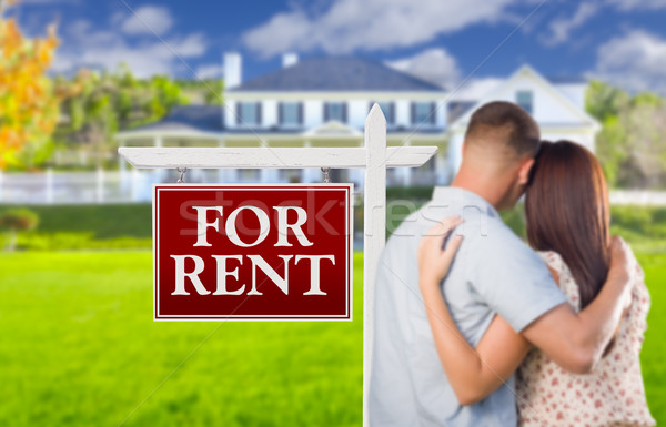 For Rent Real Estate Sign, Military Couple Looking at House Stock photo © feverpitch