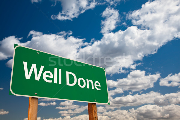 Well Done Green Road Sign with Sky Stock photo © feverpitch