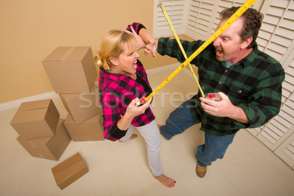 Couple Having Fun Sword Fight with Tape Measures Stock photo © feverpitch