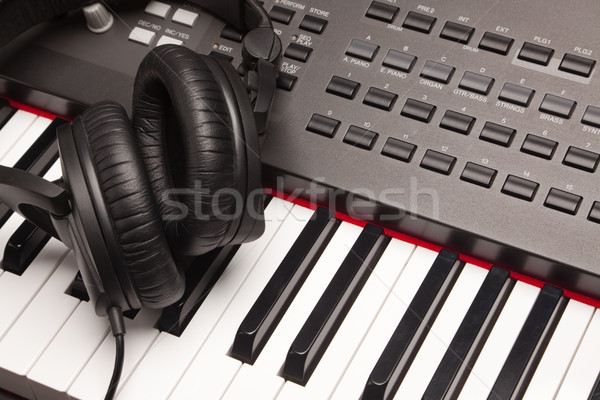 Listening Headphones Laying on Electronic Synthesizer Keyboard Stock photo © feverpitch