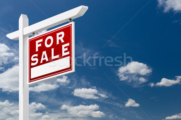 Right Facing For Sale Real Estate Sign Over Blue Sky and Clouds  Stock photo © feverpitch