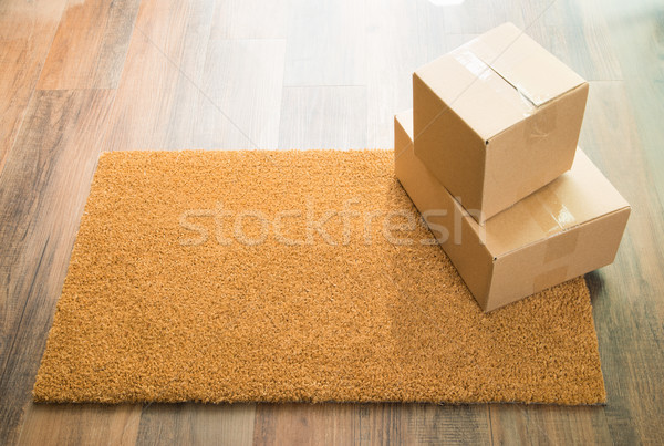Blank Welcome Mat On Wood Floor With Shipment of Boxes Stock photo © feverpitch