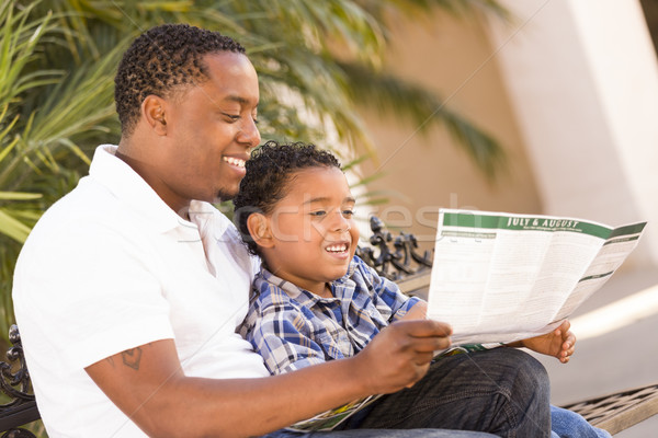 Mixed Race Father and Son Reading Park Brochure Outside Stock photo © feverpitch