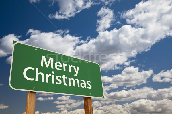 Merry Christmas Green Road Sign Over Clouds and Sky Stock photo © feverpitch