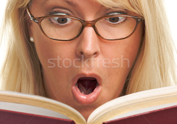 Attractive Woman Taken Back While Reading  Stock photo © feverpitch