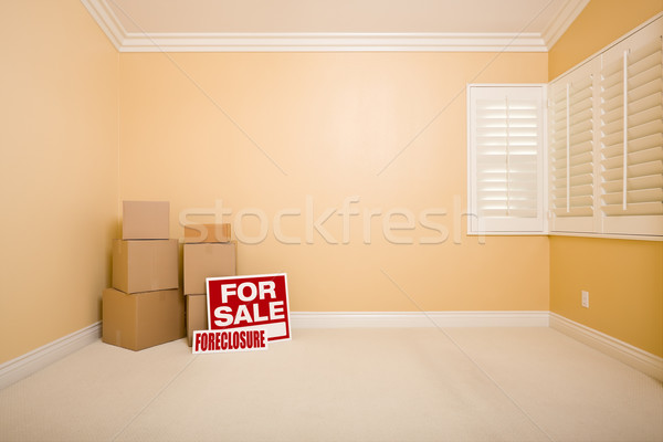 Boxes, Sale and Foreclosure Real Estate Signs in Empty Room Stock photo © feverpitch