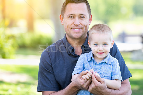 Young Caucasian Father and Son Having Fun At The Park Stock photo © feverpitch
