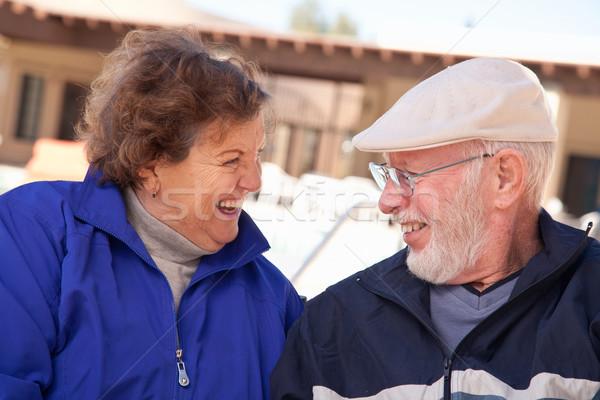 Happy Senior Adult Couple Bundled Up Outdoors Stock photo © feverpitch