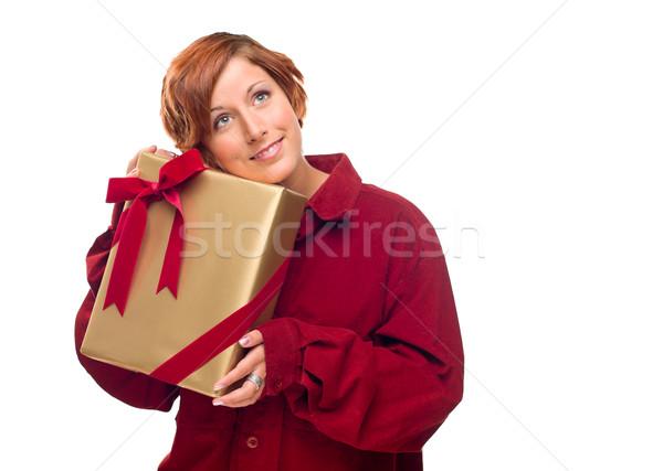 Csinos piros lány ajándék izolált fehér Stock fotó © feverpitch
