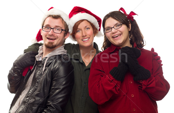 Three Friends Wearing Warm Holiday Attire Stock photo © feverpitch