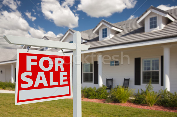 Stock photo: Home For Sale Real Estate Sign and House - Left