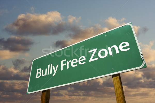 Bully Free Zone Green Road Sign and Clouds Stock photo © feverpitch