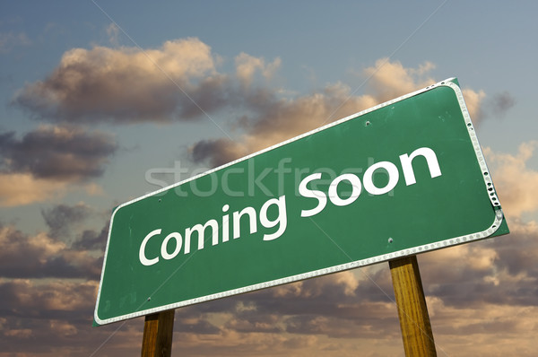 Coming Soon Green Road Sign Over Clouds Stock photo © feverpitch