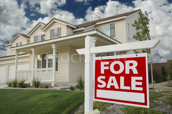 Home For Sale Real Estate Sign and New House