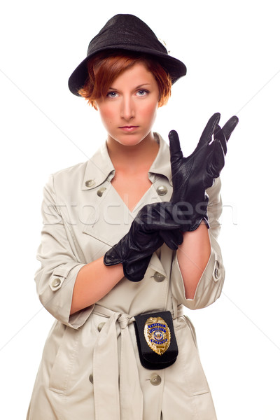 Red Haired Female Detective Putting on Gloves Wearing a Trenchco Stock photo © feverpitch