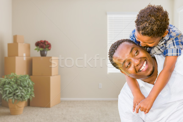 Mixed Race African American Father and Son In Room with Packed M Stock photo © feverpitch