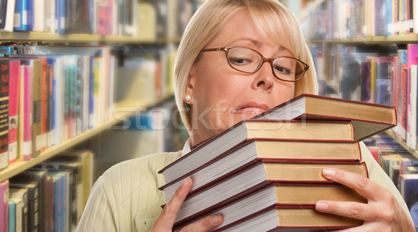 Beautiful Expressive Student or Teacher with Books in Library. Stock photo © feverpitch