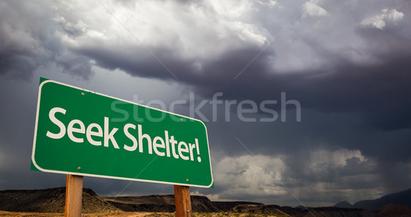 Seek Shelter Green Road Sign and Stormy Clouds Stock photo © feverpitch