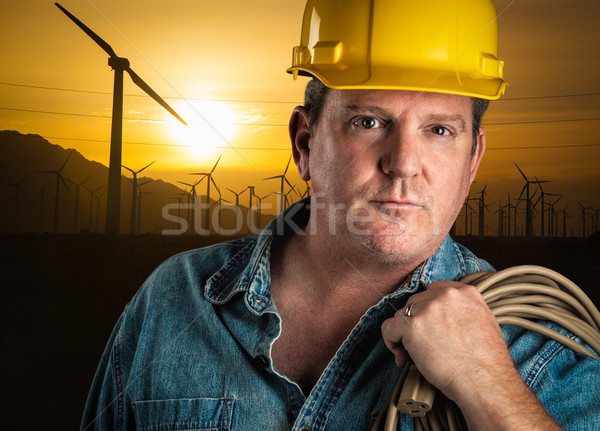 Serious Contractor in Hard Hat Holding Extention Cord Outdoors N Stock photo © feverpitch