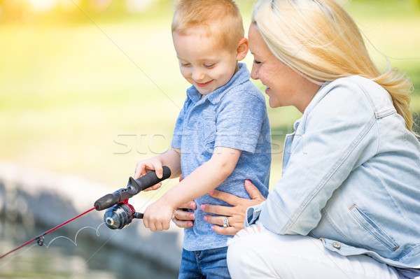 Young Caucasian Mother and Son Having Fun Fishing At The Lake Stock photo © feverpitch