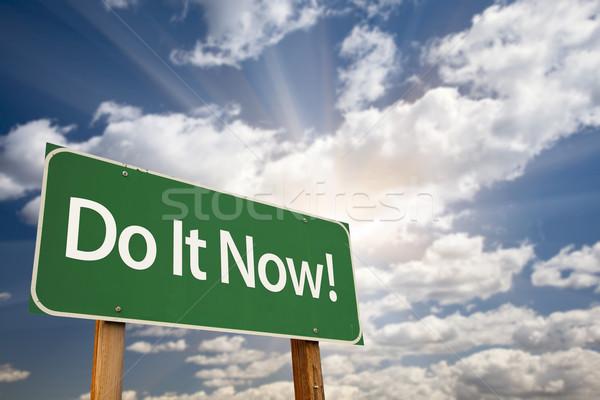 Do It Now! Green Road Sign and Clouds Stock photo © feverpitch