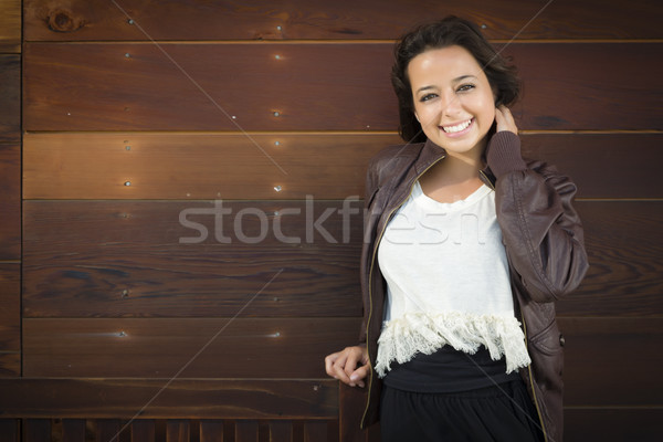 Mixed Race Young Adult Woman Portrait Against Wooden Wall Stock photo © feverpitch