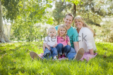 Beautiful Young Family Portrait Outside on Grass Stock photo © feverpitch