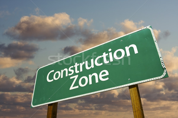 Construction Zone Green Road Sign and Clouds Stock photo © feverpitch