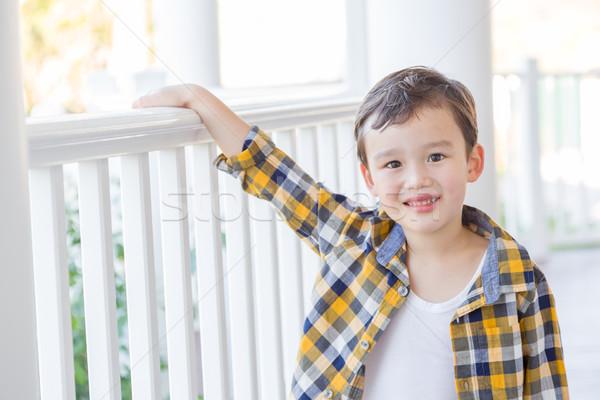 Fiatal félvér fiú elöl veranda kínai Stock fotó © feverpitch