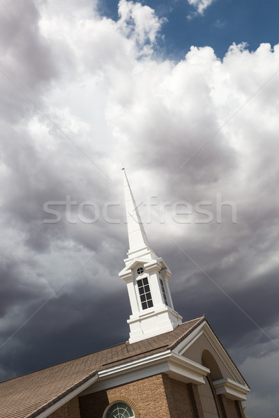 Church Steeple Tower Below Ominous Stormy Thunderstorm Clouds. Stock photo © feverpitch