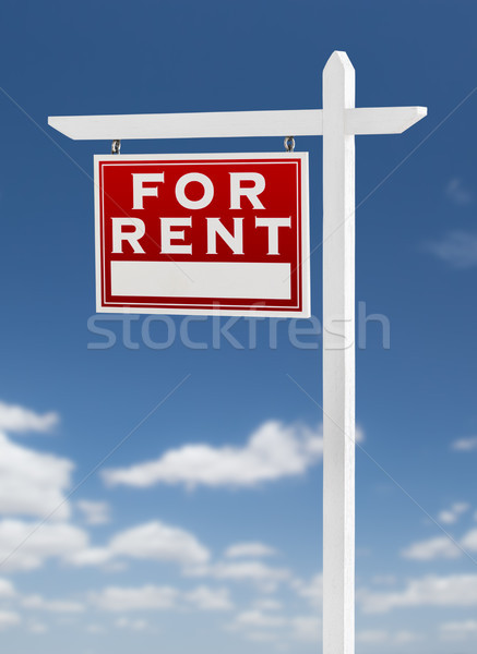 Left Facing For Rent Real Estate Sign on a Blue Sky with Clouds. Stock photo © feverpitch