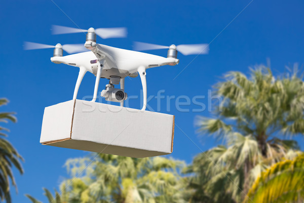 Unmanned Aircraft System (UAV) Quadcopter Drone Carrying Blank P Stock photo © feverpitch
