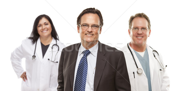 Businessman with Medical Personnel Behind Stock photo © feverpitch